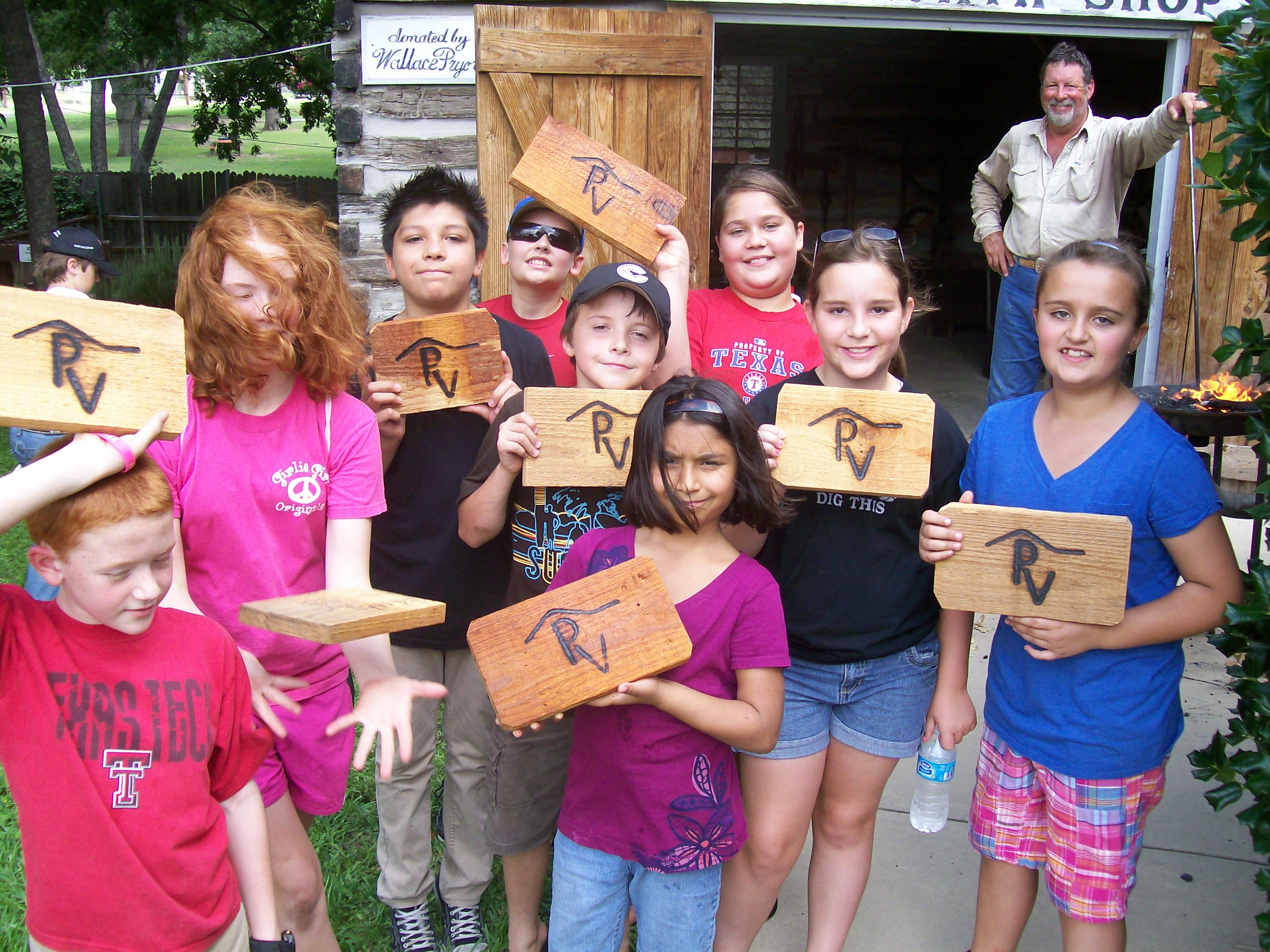 Summer Programs kids with PV wooden signs