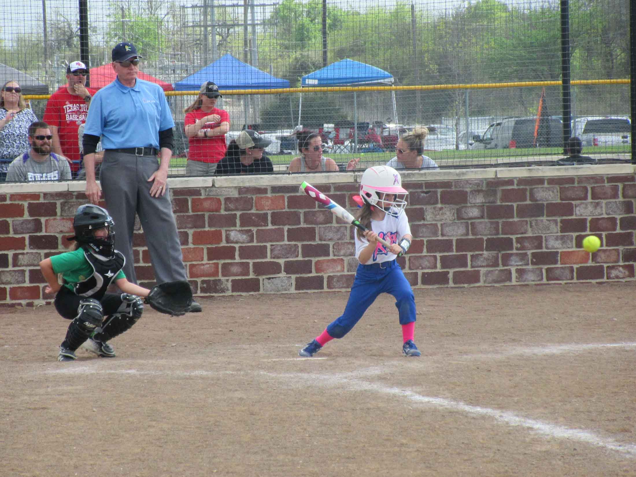Girl hitting the ball